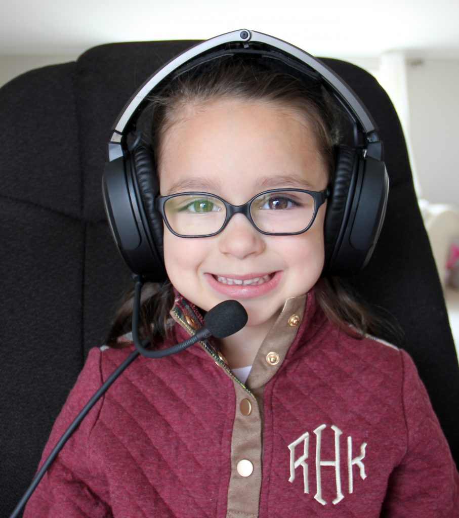 toddler wearing bose aviation a20 headset