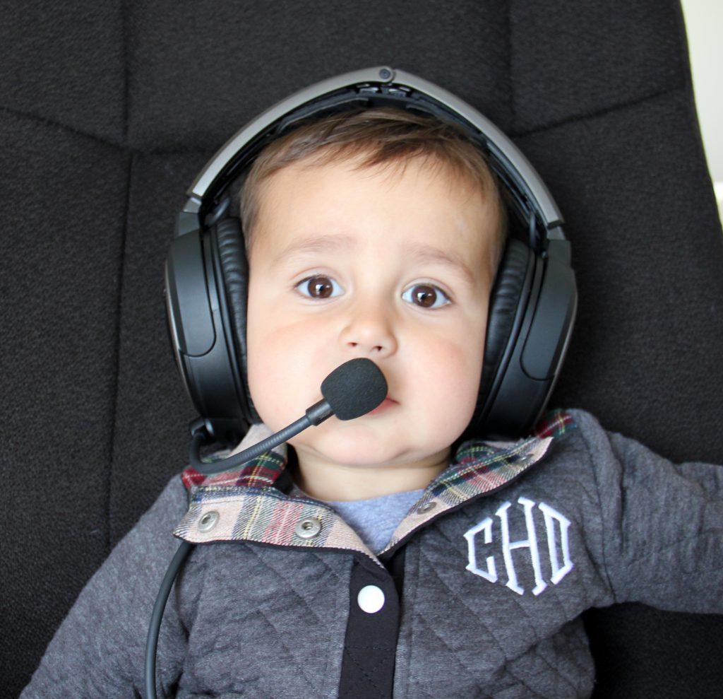 2 year old wearing bose aviation headset