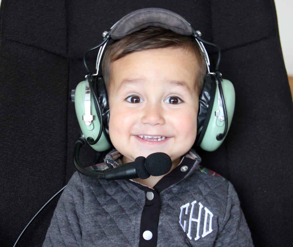 toddler wearing david clark aviation headset