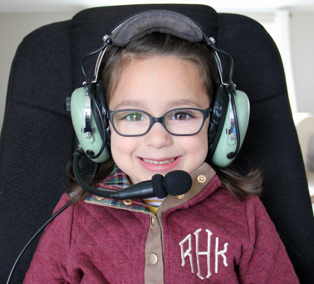 kid wearing david clark aviation headset