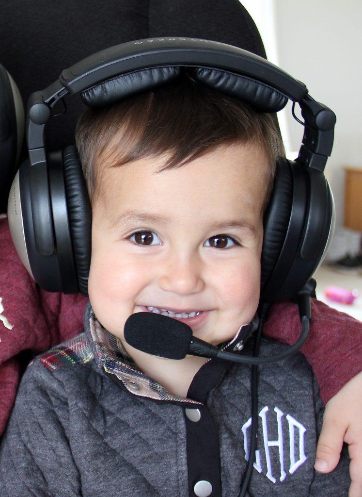 toddler wearing lightspeed sierra aviation headset